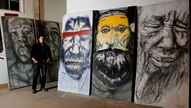 Stephen Watkins pictured with his artwork.