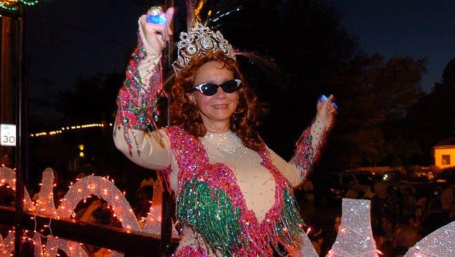 Head Sweet Potato Queen Jill Conner Browne dances on her float during a past Zippity Doo Dah Parade.