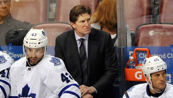 Toronto Maple Leafs coach Mike Babcock, center, looks on during a game against the Florida Panthers.