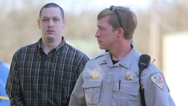 John Dylan Adams is escorted into the Decatur County Courthouse to appear in Judge C. Creed McGinley's courtroom for a status hearing in the Holly Bobo case, in Decaturville on Wednesday.