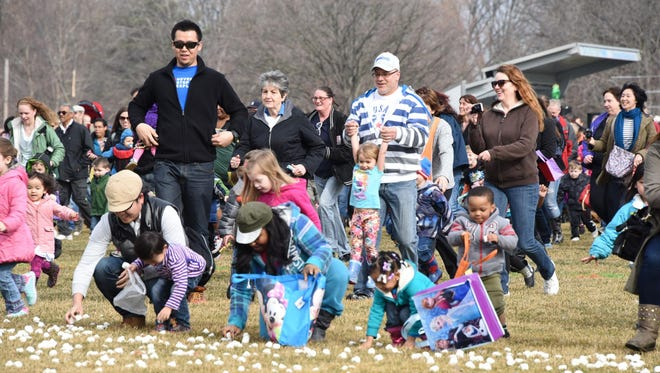 Thousands of children and their families come out to the Great Marshmallow Drop at Catalpa Oaks County Park in Southfield.