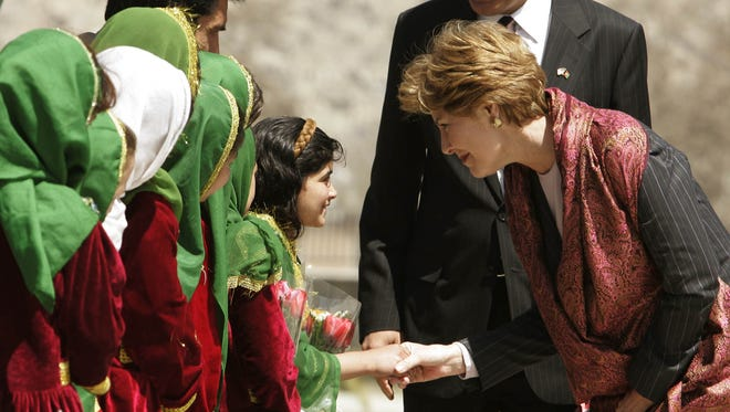 Laura Bush is greeted by Afghan schoolchildren upon her arrival at Kabul on March 30, 2005