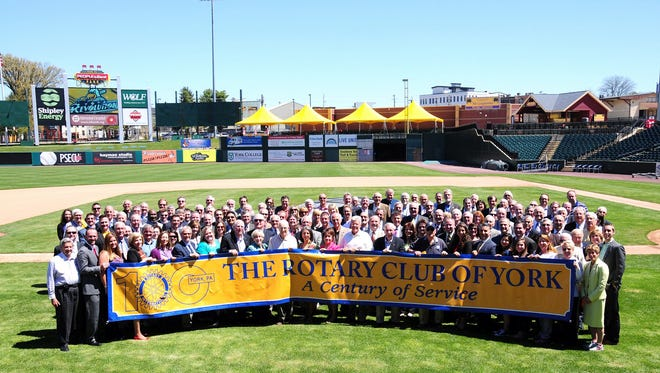 Rotary Club of York members gather at PeoplesBank Park to commemorate the 100th Anniversary of the Rotary Club of York