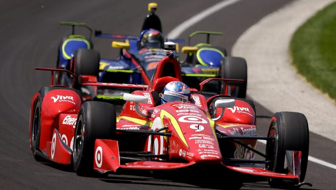 IndyCar driver Scott Dixon rounds turn one during Indy 500 practice at Indianapolis Motor Speedway on May 23, 2016.
