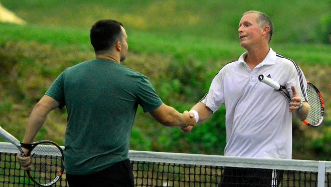 Phil Myers, left, congratulates Jim Kohr after the York City-County Tennis Tournament Mens Open Singles title match at Wisehaven, Wednesday, June 15, 2016. Kohr and Myers are seeded first and second, respectively, for the 2017 tournament, which begins on Thursday. John A. Pavoncello photo