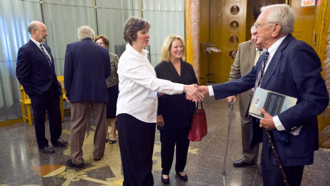 Louis J. Appell Jr., right, is greeted Monday by Francis Wolf, the wife of Tom Wolf outside of Stephen Stetler's trial in 2012.
