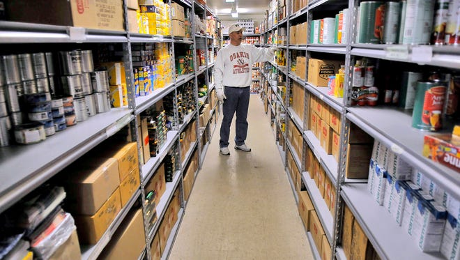Volunteer Thomas Kleis, St. Cloud, talks about the items that families get when they come to the food shelf at the Salvation Army shelter in 2009 in St. Cloud.