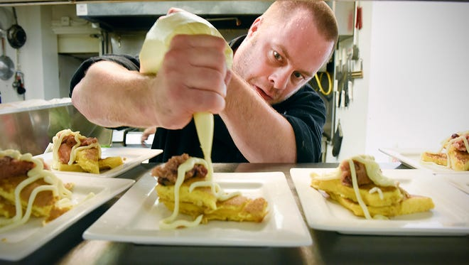 Chef Jason Kurtz topped his brioche pan purdue cashew toffee and apple nutmeg chutney desert before serving Monday, Aug. 8, 2016, at MC's Dugout Bar and Grill. Chef Kurtz and Castle Danger Brewery paired a four-course dinner with different beers for guests.
