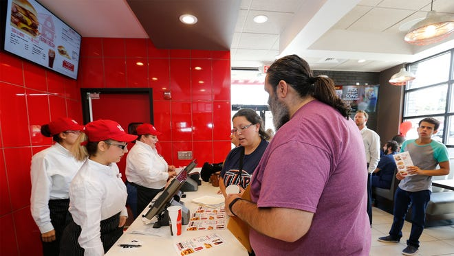 Business was booming Thursday at the new Johnny Rocket's hamburger chain location at Mesa and University in West El Paso. It opened Wednesday.