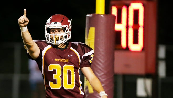 McCutcheon's Darren Lathrop celebrates after scoring to put the Mavericks up 20-13 with 1:29 remaining against West Lafayette Friday, August 26, 2016, at McCutcheon High School. McCutcheon defeated West Lafayette 35-28 2OT.
