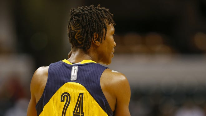 Indiana Fever forward Tamika Catchings (24) backpedals back to play defense against the Phoenix Mercury at Bankers Life Fieldhouse on Sept. 21, 2016.