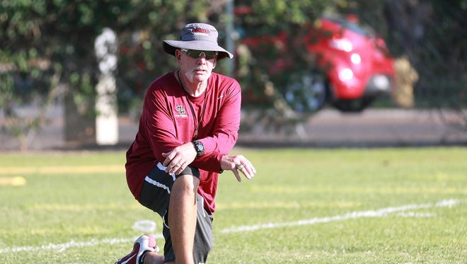Mt. Whitney head football coach Marty Martin watches over a Pioneers practice.