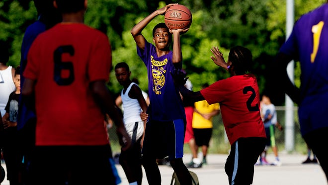 Wesley Higgans shoots during a game at Meaux Park in Milwaukee on July 20.