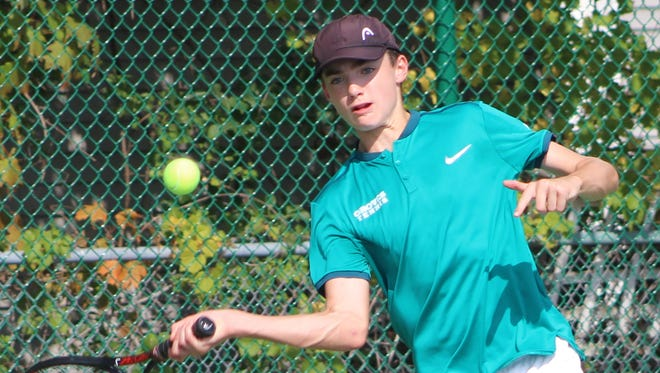 Groves sophomore Gabe Liss concentrates on a return shot at No. 1 singles, where he won in straight sets to help lead his team to its first regional crown in six years.