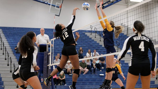 Waverly's Malin Smith (left) tries to get past Grand Ledge's Julia Jaros' (right) block during round one of the girls volleyball district tournament against Waverly on Tuesday, Nov. 1, 2016 at DeWitt High School. Grand Ledge took down Waverly in three sets.