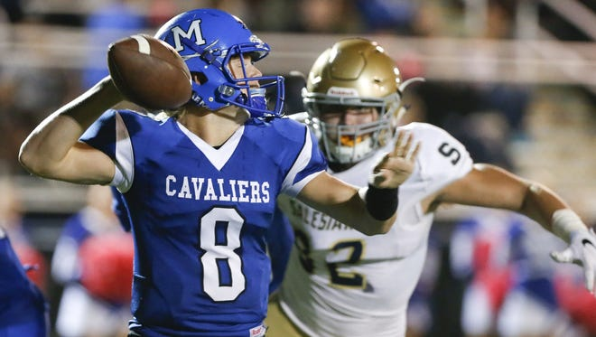Middletown quarterback Drew Fry, seen here against Salesianum, threw for three touchdowns as the Cavaliers romped to a victory against Newark on Friday night.