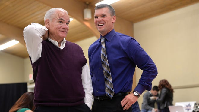 Ingham County Sheriff candidate Scott Wriggelsworth, right, talks with his father Gene L. Wriggelsworth, Ingham County Sheriff, at his watch party on Tuesday, Nov. 8, 2016 at the UA Local 333 Plumbers and Pipefitters union hall in Lansing.