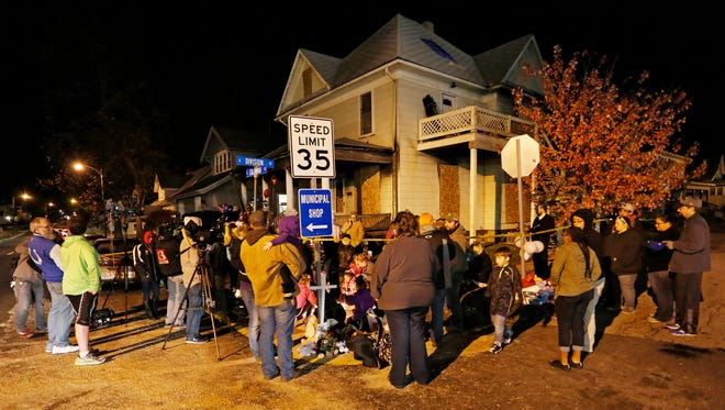 Residents gather for a candlelight vigil Tuesday, November 22, 2016, for four children who died in a house fire Monday in Flora. Kionnie Precious Welch, 5, Kerriele Danyell McDonald, 7, Keyara Janell Phillips, 9, and Keyana Latrice Davis, 11, died of asphyxiation due to smoke inhalation. The children's mother, Gaylin Rose, is in critical but stable condition at an Indianapolis hospital.