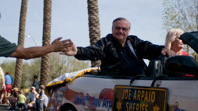 Sheriff Joe Arpaio greets a fan at one of the many parades he's participated in.