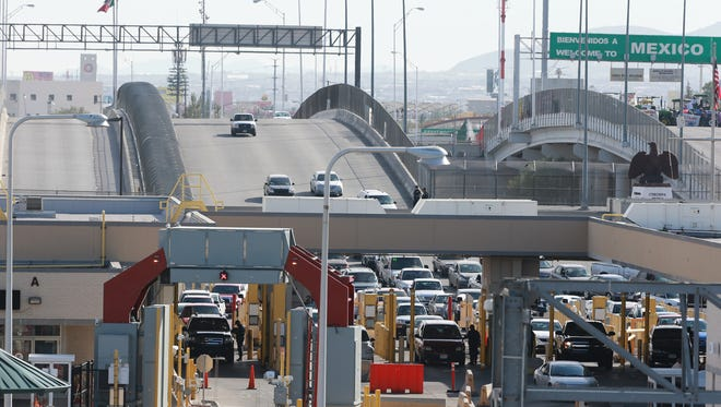 Cars head north into the U.S. at the Bridge of the Americas between El Paso and Juárez. A new report from the Federal Reserve Bank of Dallas concludes that the North American Free Trade Agreement helped cities on the U.S.-Mexico border.