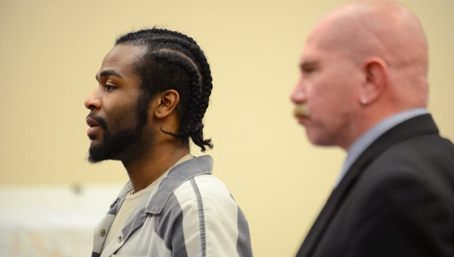 Charles Lewis Jr. gives a statement to the court as he appears alongside his attorney Keith Watson on Wednesday, Feb. 15, 2017 for sentencing in the 2010 murder of Shayla Johnson in Ingham County Circuit Court in Lansing. Lewis was sentenced to 27-62 years in prison.