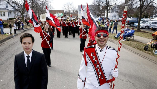 Cornell University Big Red Marching Band acting head manager Jeffrey Van, left, a freshman, and drum major Sergio Preciado, a junior, lead the band last year during the St. Patrick's Day Parade in Horseheads.