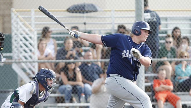 Redwood's Jace Chamberlin belts a run in against El Diamante on April 19, 2016 in Visalia. Chamberlin is a team captain this season.
