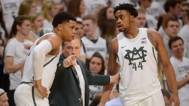 Head coach Tom Izzo talks to freshman forward/guard Miles Bridges, left, and freshman forward Nick Ward during the game against Michigan on Sunday, Jan. 29, 2017 at the Breslin Center. Michigan State won, 70-62.