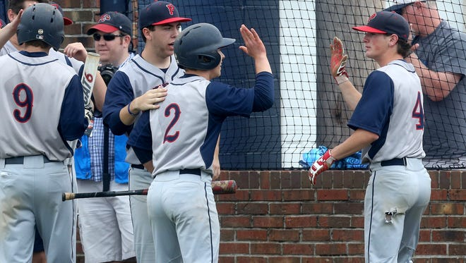 Jefferson County's Tyler Franklin (2) celebrates with teammate Tyler Shaver (4) after tying the game 3 to 3 in the 6th inning of game 12 of the Class AAA Baseball Tournament during Spring Fling on Thursday, May 25, 2017.