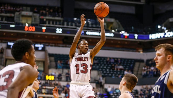Tindley TigersÕ Eric Hunter (13) goes up for a shot late in the game against the Lafayette Central Catholic Knights during the IHSAA Class A state championship game at Bankers Life Fieldhouse in Indianapolis on Saturday, March 25, 2017.