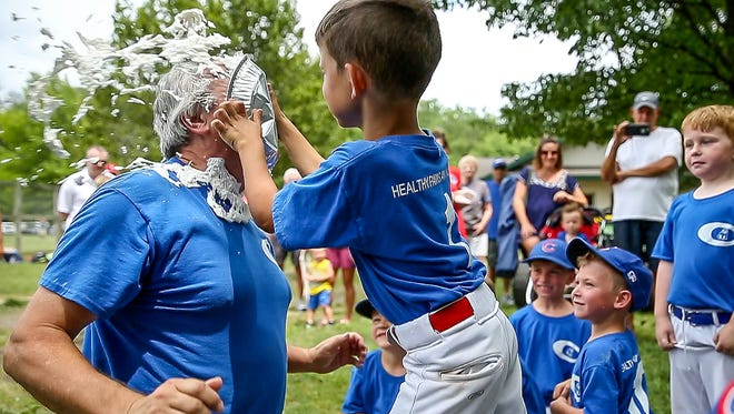 """After every game Brent Pope, president of the Danville Pee Wee Baseball league and coach of the Cubs, gives his players the opportunity to hit him in the face with a pie. Colton Phillips got his turn after the Cubs' final game of the season on Saturday, June 17, 2017. """"At this age kids start asking when the game's going to be over,"""" said Pope. """"This gives them something to look forward to."""""""