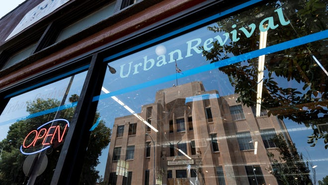 Urban Revival windows reflect Tulare County's old courthouse on Court Street on Thursday, Aug. 17, 2017. The County may be looking to find interested parties to bring this old building back to life.