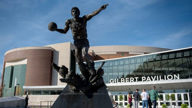 """The Earvin """"Magic"""" Johnson statue stands outside the Gilbert Pavilion during the Gilbert Pavilion and Tom Izzo Hall of History dedication on Friday, Oct. 20, 2017, at the Breslin Center in East Lansing."""