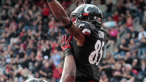 Teammates lift up Thomas Geddis after he made a catch in the end zone for the Bearcats. The UC Bearcats take on the SMU Mustangs out of the American West Conference for their 2017 Homecoming Game.