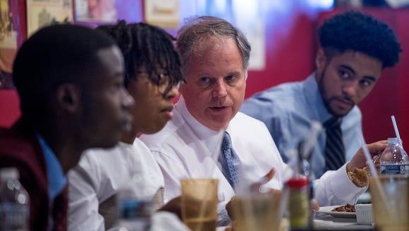 U.S. Senate candidate Doug Jones eats lunch with Alabama