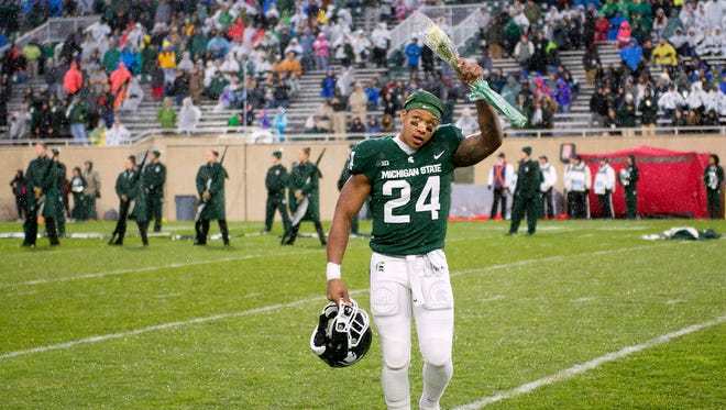 Michigan State senior Gerald Holmes acknowledges the crowd during a senior day recognition before the start of the game on Saturday, November 18, 2017, at Spartan Stadium in East Lansing.