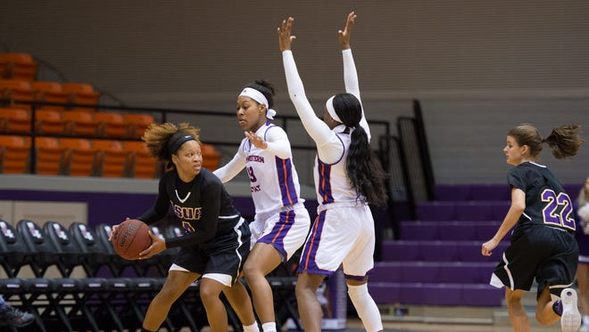 LSUA's Alexis Harris (4) looks for an open teammate in Wednesday's game against NSU.