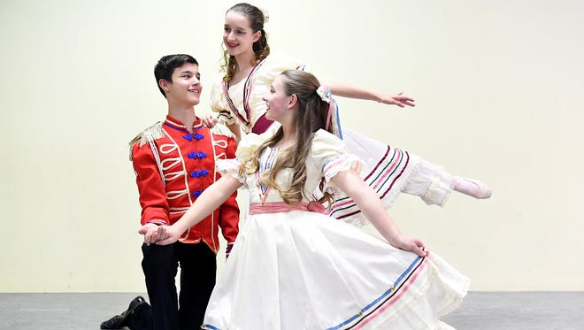 Joe Milam poses with Grace Peeples and Reese Davis as they will portray The Prince/Nutcracker and Claire in Ballet Arts of Jackson's rendition of The Nutcracker, December 8-10 at the Carl Perkins Civic Center.