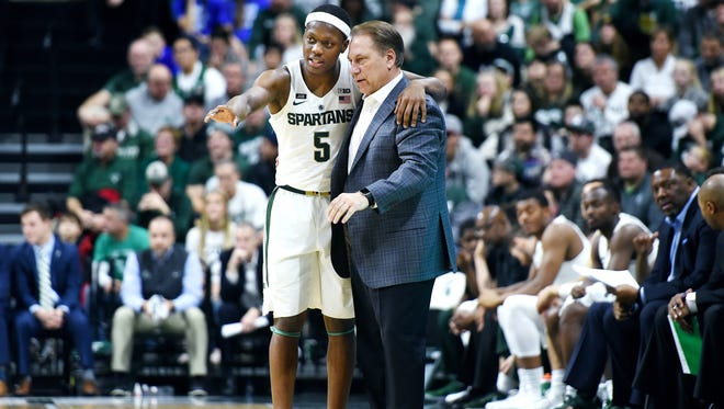 Michigan State's Cassius Winston, left, talks with head coach Tom Izzo during the first half on Friday, Dec. 29, 2017, at the Breslin Center in East Lansing.