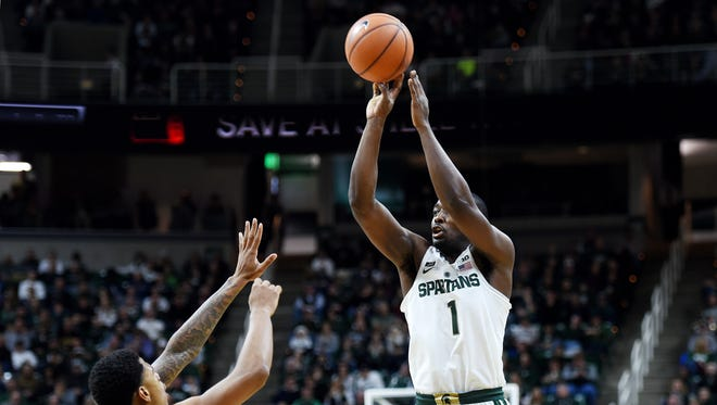Michigan State's Joshua Langford, right, shoots a 3-pointer as Cleveland State's Anthony Wright defends during the second half on Friday, Dec. 29, 2017, at the Breslin Center in East Lansing. The Spartans won 111-61.