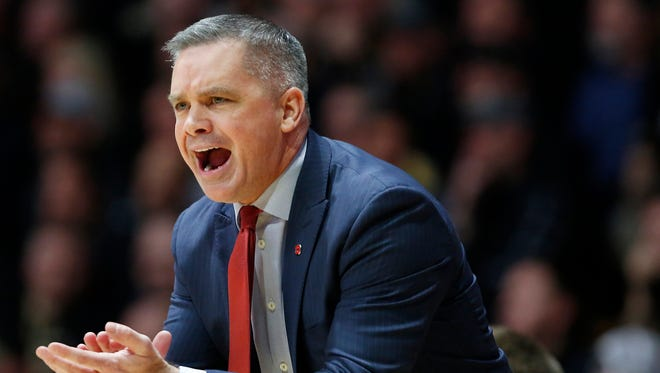 Ohio State head coach Chris Holtmann shouts instructions to the Buckeyes as they face Purdue Wednesday, February 7, 2018, at Mackey Arena. Ohio State upset Purdue 64-63.
