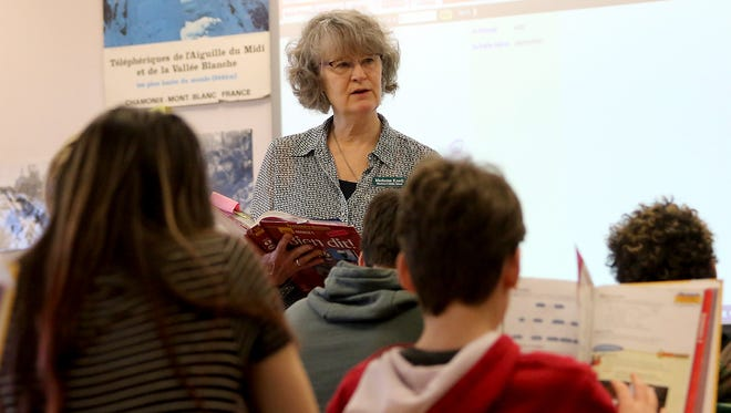 Woodward Middle School teacher Susan Knell goes through the textbook with her French students during class on Bainbridge Island. Knell has been honored for her efforts to educate students on recycling.
