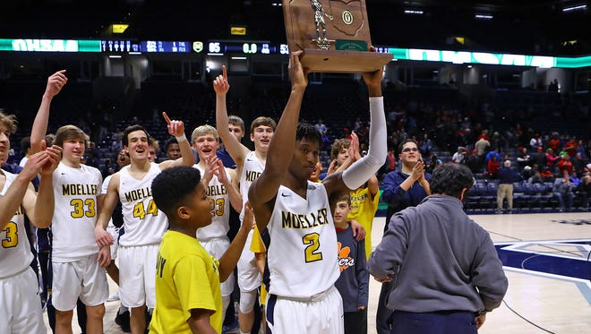 Moeller players celebrate after winning the OHSAA Regional Championship Final at Xavier University. Moeller defeated Wayne 65-53 and moves on to the OHSAA Final Four next week.