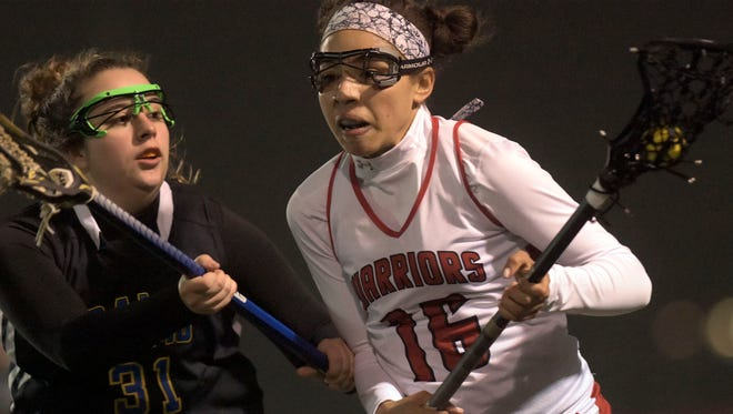 Susquehannock's Ashley Grimes moves the ball with pressure from Kennard-Dale's Autumn Kramerduring lacrosse action at Susquehannock Tuesday, April 3, 2018. Bill Kalina photo