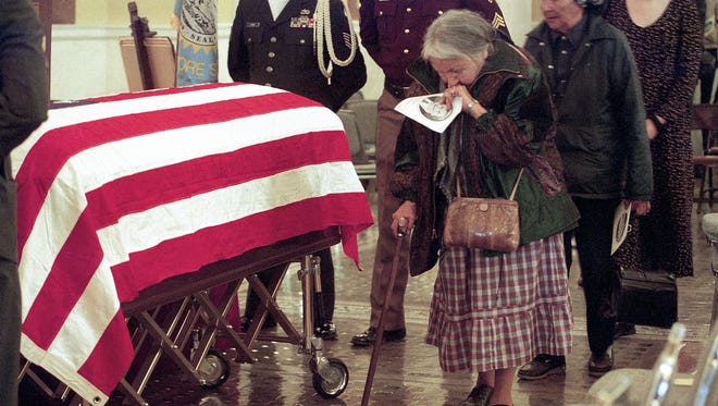 Sarah Brave, 80, Oglala, weeps for Governor George Mickelson as she paused at his flag-draped casket in the rotunda of the South Dakota Capital.