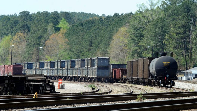 "Containers that were loaded with tons of sewage sludge in Parrish, Ala. More than two months after the so-called ""poop train"" rolled in from New York City, the small town smells like rotting corpses."