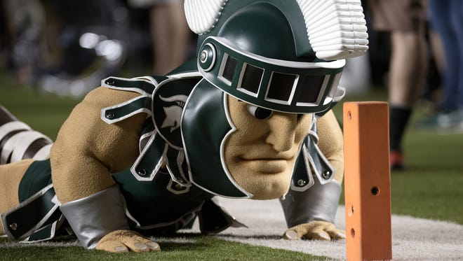 Michigan State's mascot Sparty hams it up for the Pylon camera during the first half on Oct. 7, 2017, at Michigan Stadium in Ann Arbor.