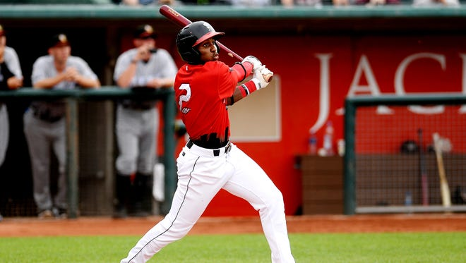 Lansing Lugnuts' Chavez Young hits a ball deep to right field in the first inning during the Midwest League All-Star game on Tuesday, June 19, 2018, at Cooley Law School Stadium in Lansing.
