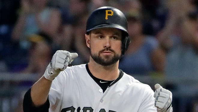Jordy Mercer drives in two runs with a single in the sixth inning.