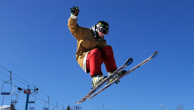 The cold weather Sunday did not stop Isaac Fromm, 15, St. Joseph, from taking the jumps in the terrain park at Powder Ridge Winter Recreation Area in Kimball.